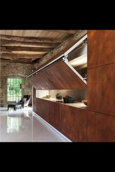 Contemporary kitchen design with folding front panels hides a cooktop and storage shelves when you do not use them. Hidden Kitchen design from Warendorf shows a new kitchen concept that is attractive, Hidden Kitchen, Nice Kitchen, Copper Kitchen, Kitchen Ideas, Closed Kitchen, Loft Kitchen, Kitchen Industrial, Kitchen Walls, Bar Kitchen