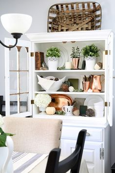 How to Style a Dining Room Hutch | JustAGirlAndHerBlog.com