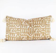 14 x 24 Pillow Cover *Please note the pillow insert is not included* -Heavy weight linen on the front -Natural cotton tassels -Heavy weight flax linen on the back -Gold metal zipper detail Best to spot or dry clean. Feather insert two sizes up recommended.