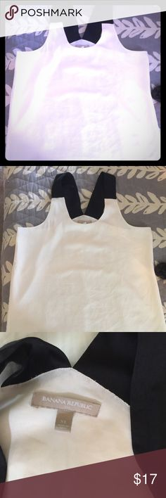 Banana Republic white top w/ black shoulder detail Worn once no signs of wear. Lined top. Looks great worn alone or can be worn under a suit Banana Republic Tops Blouses