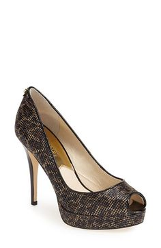 MICHAEL Michael Kors 'York' Platform Peep Toe Pump | Scintillating leopard-print fabric illuminates a sultry peep-toe pump lifted by a high-rise patent heel.