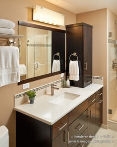 Modern 3/4 Bathroom with frameless showerdoor, Undermount sink, Pental Quartz Crystal White, Quartz counters, Flush