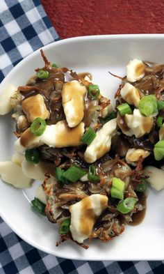 These little potato bites topped with gravy, cheese curds and scallions are the perfect thing to serve for a fun breakfast, brunch or late-night snack. Canadian Dishes, Canadian Cuisine, Little Potatoes, Potato Bites, Cheese Curds, Food Network Canada, Poutine, Night Snacks, Best Breakfast