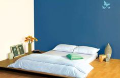 Dark Blue Bedroom! Feature wall in Caspian Sea 7294 with Neutral on other walls. Butterfly stencil in Caribbean Green 7512