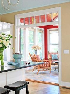 Looking into the raspberry sunroom from the kitchen. Love the transom window.