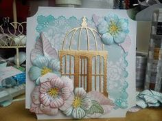 """Birthday card with gold foil birdcage on. Background roses paper from Pink Petticoat; all flowers made using Penny Black 'Petal Party' stamps on different coloured Pink Petticoat papers. Ink used: Various momento dew drop ink pads. Size 6x6"""""""