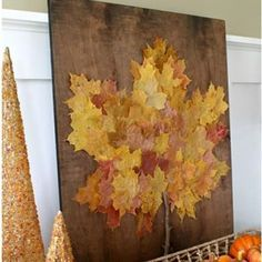 Easy DIY fall crafts with leaves: Use a projector to trace a leaf shape onto a board, then use Mod Podge to adhere pre-arranged leaves to the wood. The result? A striking wall display.