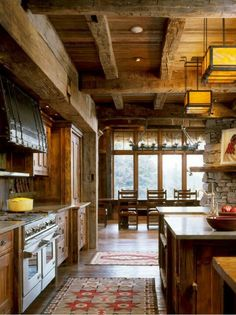 Rustic exposed wood beams and wood ceiling are a must for this mountain home.