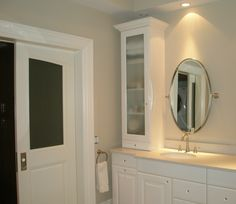 Crystal knobs.  White lacquer cabinets.  Original doors.