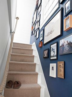 Line Your Stairway one side with black, wood plain frames-up to banisters and no higher than door frame height-leaving from staircase and beginning in line with opposite banister Narrow Staircase, Staircase Design, Staircase Ideas, Stairway Paint Ideas, Stairs And Hallway Ideas, Cottage Staircase, Banister Ideas, Handrail Ideas, Stair Walls