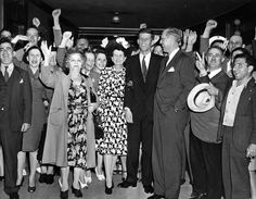 Congressman-elect Kennedy 1946; with parents and supporters