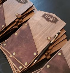 Wood and Leather Check Presenter Check Presenters These leather and wood bill presenters are hand crafted for you from real top grain leather and wood Check Presenter, Wood Menu, Gravure Laser, Restaurant Menu Design, Signage Design, Leather Projects, Leather Accessories, Wood Design, Woodworking Crafts