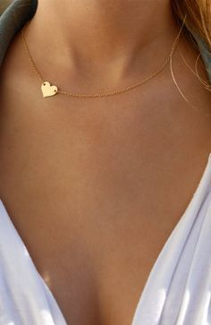"""Small Sideways Gold or Silver Heart Necklace in 14K Gold Fill or Silver  Filled.  Model is wearing the gold heart at 15""""  Made to be worn on the side.  Please allow up to five days to produce. If urgent delivery is required,  please contact us before placing your order."""
