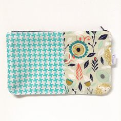 Zipper pouch aqua houndstooth lions and flowers turquoise yellow  by steepedtee on Etsy https://www.etsy.com/listing/230863728/zipper-pouch-aqua-houndstooth-lions-and