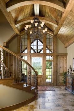 """Our rustic approach to a """"Wow!"""" worthy entry!  The ceiling, slate floors, door, and stairway were all custom-designed for our home buyer! (Home Design & Decor by B.L. Rieke & Associates, Inc.) Visit us at blrieke.com"""