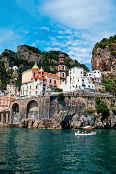 "Travelers enjoy a boat cruise in the sparkling waters of the Amalfi Coast. See this on the GCCL ""Tuscany & the Amalfi Coast"" tour. For more information please visit http://www.gct.com/Trips/2013/Tuscany-and-the-Amalfi-Coast-2013.aspx #italy"