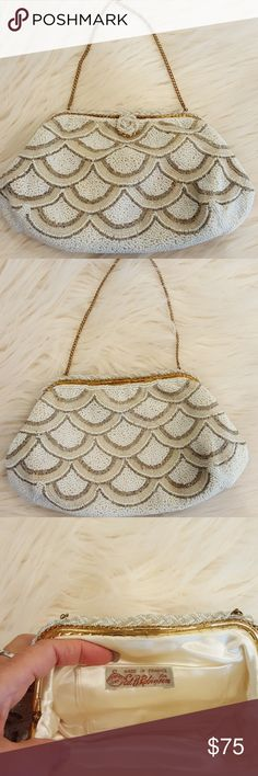 GOLD SILVER SCALLOPED VTG BAG Excellent vintage condition and style! No beads missing, all intact. Has 4 inch little pocket inside. Lined in cream satin silk. Stunning!!! Has 14 inch little gold chain to carry! 9 x 6. Made in France label, for Ed B Robinson. vintage Bags