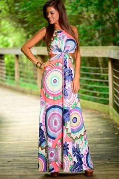 This twisted maxi is awesome! This vibrant beauty has such a fun design! The side cut-outs plus the open back is perfection! It is so dreamy and it is the perfect summer look!
