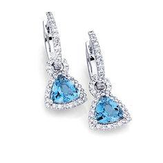 Sparklet Collection - These enticing 18K white earrings feature 1.23ctw trillion cut natural Aquamarine center stones and .41ctw round white Diamonds. - LP3886