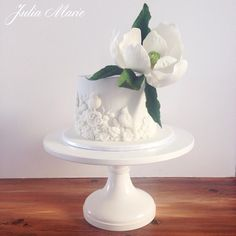 Magnolia Bas Relief Cake by Julia Marie Cakes - http://cakesdecor.com/cakes/217868-magnolia-bas-relief-cake