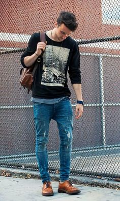 This combo of a black print crew-neck pullover and blue jeans will enable you to keep your off-duty style clean and simple. Brown leather brogues will bring a classic aesthetic to the ensemble.   Shop this look on Lookastic: https://lookastic.com/men/looks/crew-neck-sweater-crew-neck-t-shirt-jeans/18249   — Brown Leather Backpack  — Black Print Crew-neck Sweater  — Grey Crew-neck T-shirt  — Blue Jeans  — Brown Leather Brogues