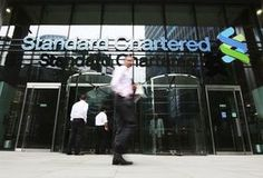 Standard Chartered hit with first S&P downgrade in 20 years