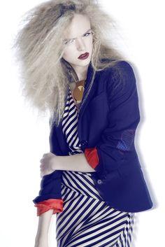 Photographer: Niklas Hoejlund www.niklashoejlund.com  fashion photography strong colors red lips blue jacket zebra dress female