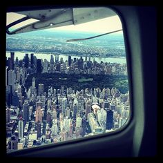 LOVE aerial photography! Sea plane over Manhattan...