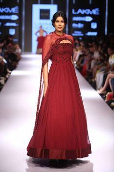 Crushing on the cape style these days? Isn't this like the perfect maroon outfit ever? See more such designs from Lakme Fashion Week 2015 on www.frugal2fab.com