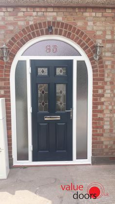 Our Oxford Composite Doors are traditional Front Doors that look beautiful in Blue. This Blue Front Door within its arched frame effortlessly establishes an exquisite front door way. Black Composite Front Door, Composite Door, House Front Porch, Front Porch Design, Front Porches, Arched Front Door, Arched Doors, Garage Door Styles, Garage Door Design