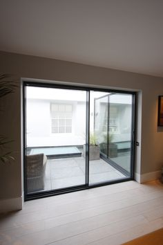 slim frame sliding glass doors to a roof extension