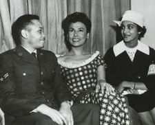 Lena Horne, talking with a serviceman and a USO volunteer (date and location unknown). Horne was outspoken in calling for better treatment of African Americans in the military, Hollywood and other aspects of U.S. life.