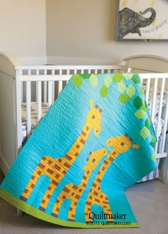 """Family of Three quilt pattern: Make the cutest crib quilt ever with Family of Three, featuring a family of giraffes under leafy tree tops. This adorable 40"""" x 52""""  quilt pattern designed by Lorna McMahon would be a perfect baby gift."""