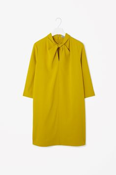 30 Awesome Dresses That Are On Sale Now #refinery29 http://www.refinery29.com/on-sale-winter-dresses#slide-1 Draw attention to your face with this knotted detail.