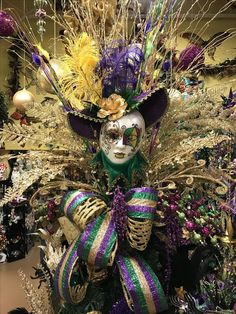 Mardi Gras tree topper designed by Arcadia Floral & Home Decor