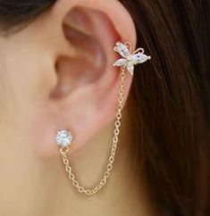 Butterfly Tassel Rhinestone Ear Cuff (Single, One Piecing) The latest hottest design! The tassel linked butterfly can be fastened with it's back hook anywhere on your ear. Ear Jewelry, Cute Jewelry, Body Jewelry, Women Jewelry, Jewelry Accessories, Silver Jewelry, Jewelry Sets, Silver Ring, Gold Rings