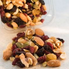 Trail mix: Just like granola, trail mix needs to be portion-controlled. You can save money—and calories—by making your own. Select the same nuts, dried fruit, and seeds, but combine them with low-cal cereal or popcorn. That way you can have a larger portion of trail mix, while still getting almonds, cranberries, and other favorites.   Health.com