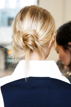 The ponytail went into retirement for a a season as hairstylists turned to a chicer, more contained style: the knot.