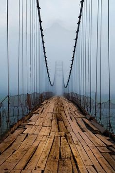 Plank Bridge, Kungur, Russia.  This suspension bridge grim and unstable aspect is in Kungur, a Russian city of 68,000 inhabitants located on the banks Sylva River, near the Ural Mountains.