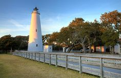 A brilliant sunset illuminates the Ocracoke Island lighthouse on the Outer Banks of North Carolina.  A fine art print. Main website: http://www.picturenorthcarolina.com Fine art gallery (buy prints): http://www.dan-carmichael.artistwebsites.com/index.html