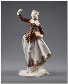 Harlequina Franz Anton Bustelli (Swiss, Locarno ca. 1720–1763 Munich) Manufactory: Nymphenburg Porcelain Manufactory Date: ca. 1763 Culture: German, Nymphenburg Medium: Hard-paste porcelain Bustelli modeled sixteen characters from the Italian commedia dell'arte, the lively improvisatory theater that came to life in the sixteenth century. Harlequin was the commedia's principal character, always dressed in a brightly colored suit of triangular patches.