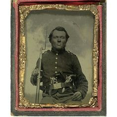 Ninth Plate Tintype of Federal with Four Weapons.  A freckled infantry private 'armed to the teeth' and uniformed in a New York-style jacket with outside slash pocket and cloth epaulettes, probably mid-war Illinois issue due to the lack of colored piping. The large bore M1809 Prussian musket, imported in large quantities as a stopgap, was synonymous with Western regiments while the brace of pistols, a Colt M1849 and early Remington-Beals, are likely the photographer's props. A final measure…