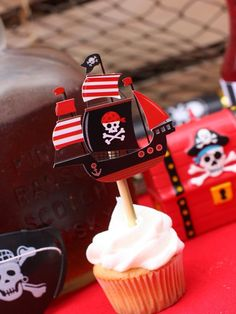 Ahoy, Halloween! Decorate in red, black and white for a pirate-themed Halloween party. Courtney spruced up vanilla cupcakes with pirate ship cupcake toppers. Fill an old rum bottle with root beer to act as decor and refreshments for guests, and serve other delicious treats in large treasure chests. From HGTV.