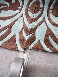 Love this hack to make a large custom rug from small ones via HGTV #diydecor