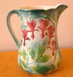 """Rare antique French majolica pitcher with """" bleeding heart"""" flowers , circa1920 made by Saint-Clément"""