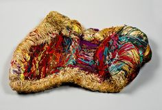 "UNTITLED (Multicolored Nest)/ Judith Scott, 1988/89, yarn and twine with unidentified armature, 8 x 36 x 25"", collection American Folk Art Museum, New York"