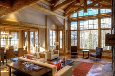 Note ceiling logs in dining area  Bercovitz Design