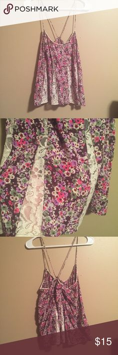 Flowered Lace Tank Top Flower print tank top with lace inlays. The straps are adjustable by tying them to the length desired. •No trades! •No offsite payment! •Pet Free! •Smoke Free! •15% off when bundled! •Reasonable offers considered! American Eagle Outfitters Tops Tank Tops