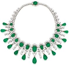 Brooke Astor's Bulgari emerald and diamond necklace, circa 1959.  Centering a flexible composition of 13 emerald drops weighing 71.00 carats, enhanced with 14 cabochon emeralds weighing 41.00 carats accented by 14 marquise-shaped diamonds weighing 8.50 carats, and set throughout with numerous round diamonds weighing 50.00 carats, length 14½ inches, unsigned, French workshop and assay marks; with signed and fitted box.