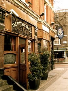 """Fitzroy Tavern in 16 Charlotte Street and corner of Windmill Street, London, W.1.  This pub was the meeting place between the two world wars for a group of writers and artists and they named the area around the pub as Fitzrovia.  There is one sign inside the pub from WW2 which states """"Business as Usual during Alterations to Germany"""""""